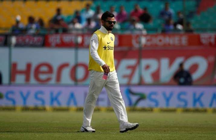 Kohli carries drinks for teammates during Dharamsala Test