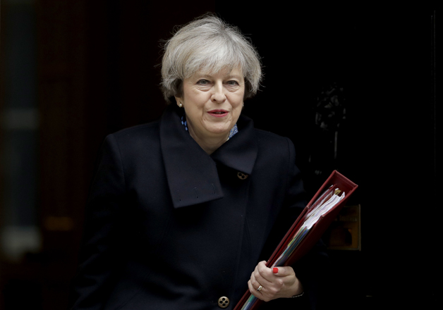 File pic - Theresa May outside 10 Downing Street in London