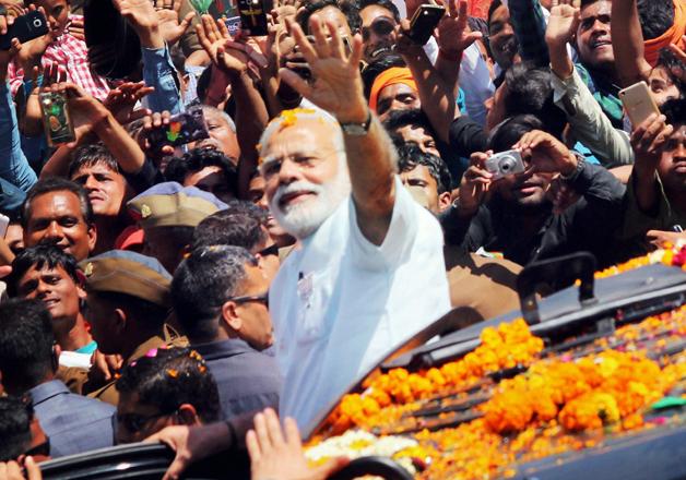 PM Narendra Modi during a road show in Varanasi