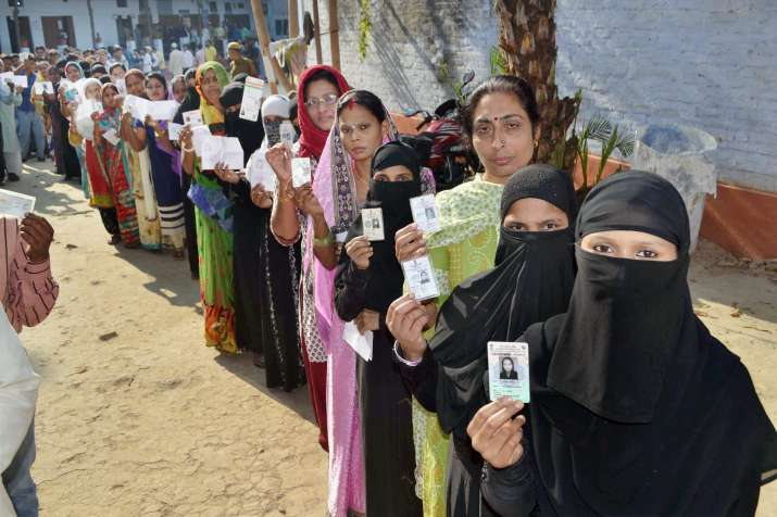 Women line up at a polling booth in Varanasi during final