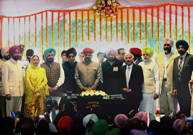 Punjab Guv with CM Amarinder Singh and his nine cabinet