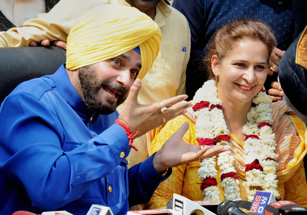 India Tv - Navjot Singh Sidhu with his wife Navjot Kaur addressing media in Amritsar