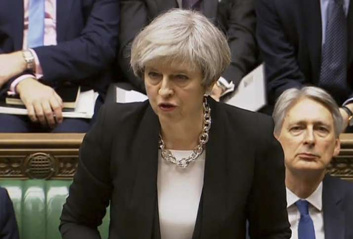 India Tv - British PM Theresa May addressed lawmakers in the House of Commons today