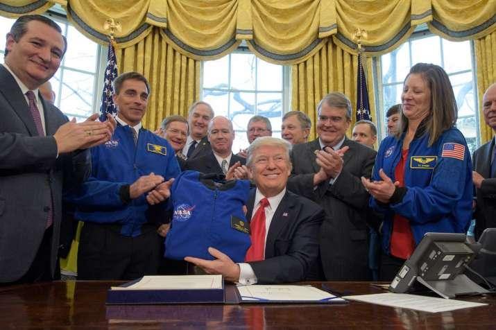 Trump signs NASA funding bill, sets goal of human on Mars
