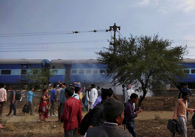 Smoke erupts from a bogie after a blast in Bhopal-Ujjain