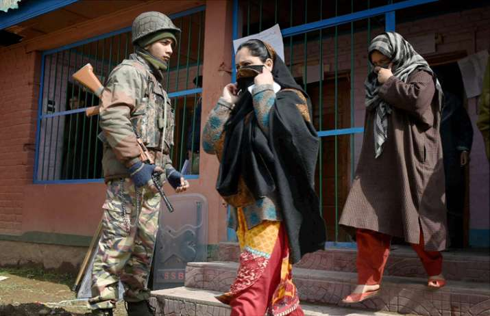 India Tv - Women coming out from a polling station after casting their vote in Srinagar