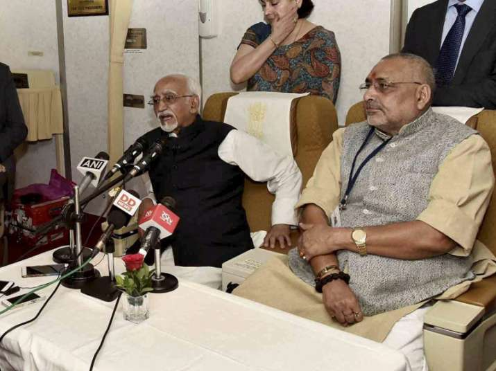Hamid Ansari, Giriraj Singh addressing media onboard AI One