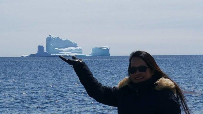 India Tv - A 150-feet iceberg floats past Canadian village