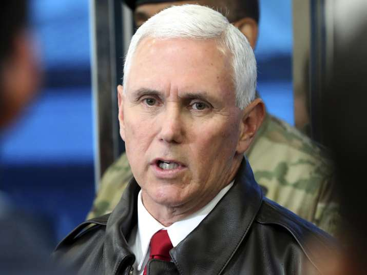 Mike Pence speaks to the media at border village of