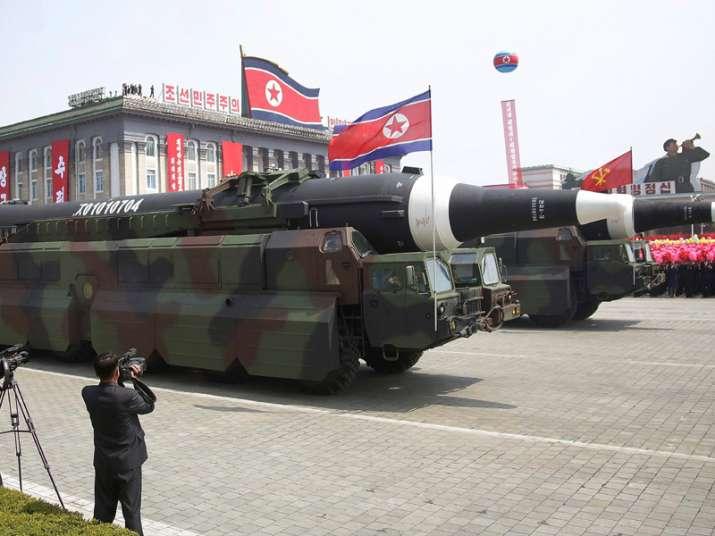 North Korea flaunts long-range missiles in massive parade