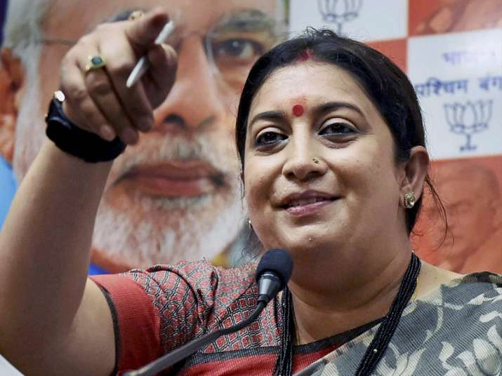 Smriti Irani interacts with media during a press conference