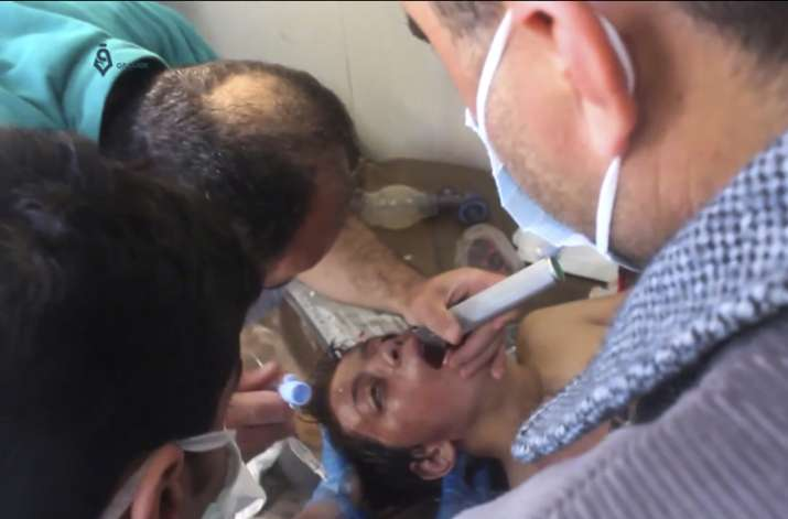 India Tv - A Syrian doctor treating a boy following a suspected chemical attack in Idlib