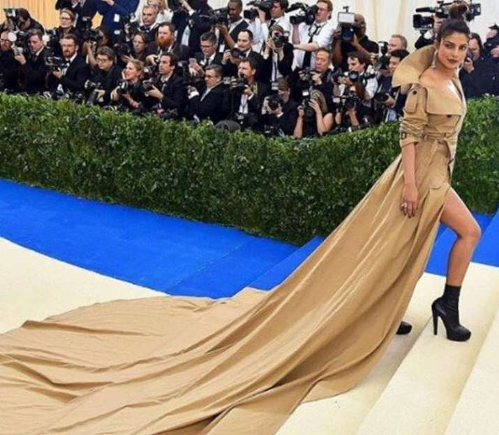 India Tv - Priyanka Chopra in brown trench coat gown at met gala 2017