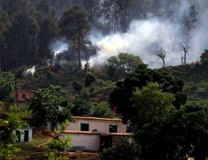 Smoke after a mortar shell was fired by Pakistan Army along