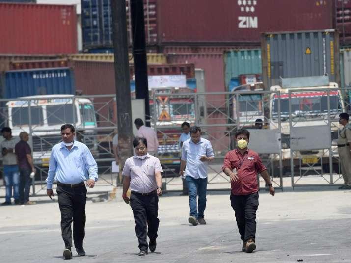 NDRF members during the clean-up operation at a container