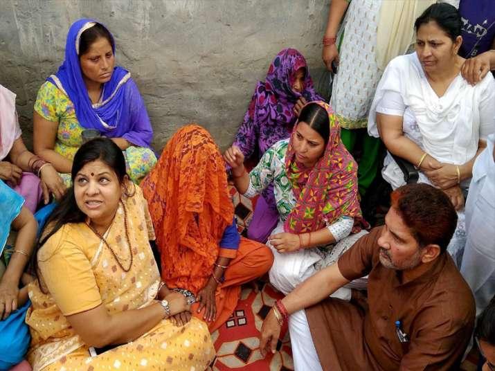 Minister Kavita Jain meeting family members of the rape