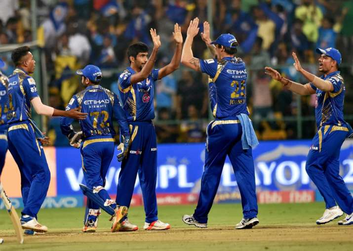 MI players celebrate during an IPL match in Bangalore