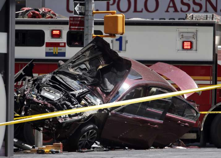 One killed as car drives into crowd in New York's Times