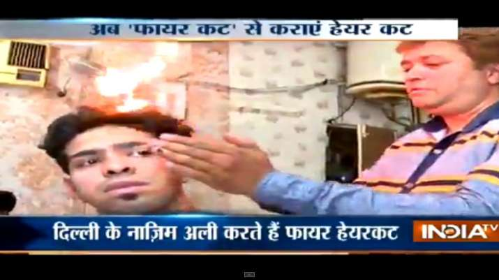 India Tv - This hair stylist uses 'fire' to cut hair and its trending among Delhi youth!