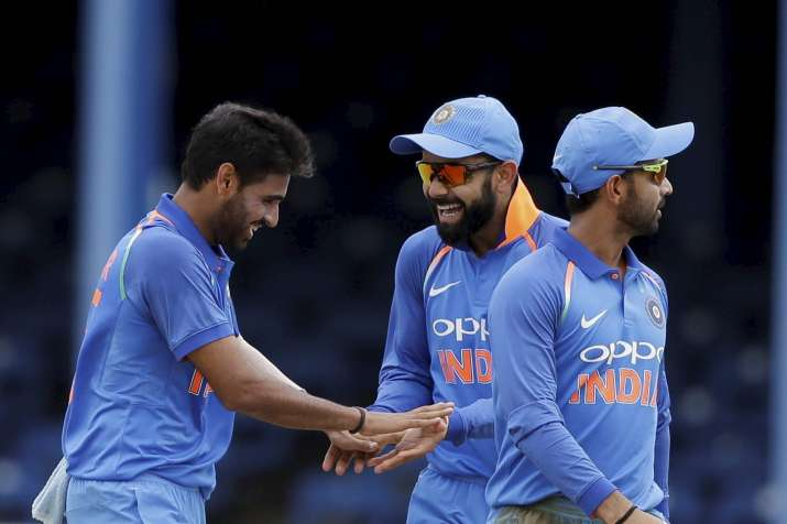 Team India celebrates a wicket against West Indies.