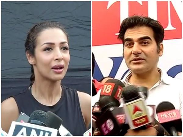India Tv - Malaika Arora and Arbaaz Khan stretched themselves on Yoga Day