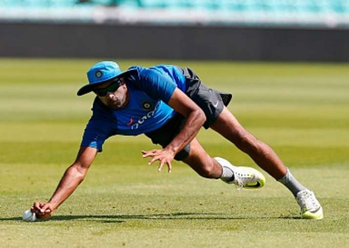 R Ashwin takes a catch during a net session.