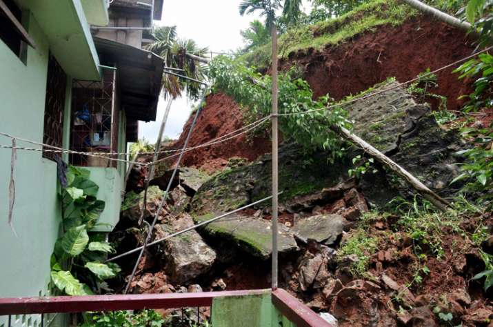a house damaged due to a landslide triggered by heavy