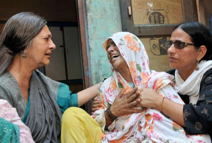 CPI(M) leader Brinda Karat consoling mother of Junaid