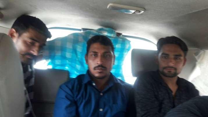 Bhim Army founder Chandrashekhar - centre - in police