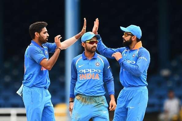 Bhuvneshwar Kumar celebrates with teammate Ajinkya Rahane