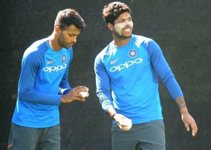 Hardik Pandya and Umesh Yadav bowl in the nets during a