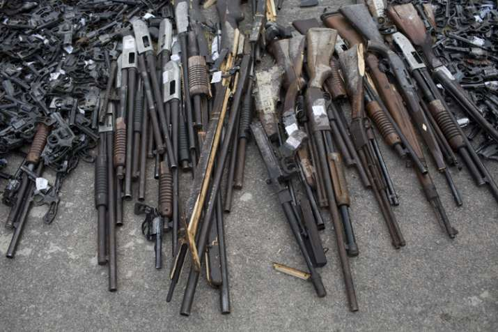 India Tv - Weapons that were confiscated by the Federal Police sit on the ground
