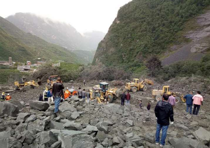 Over 100 people feared buried in southwest China landslide
