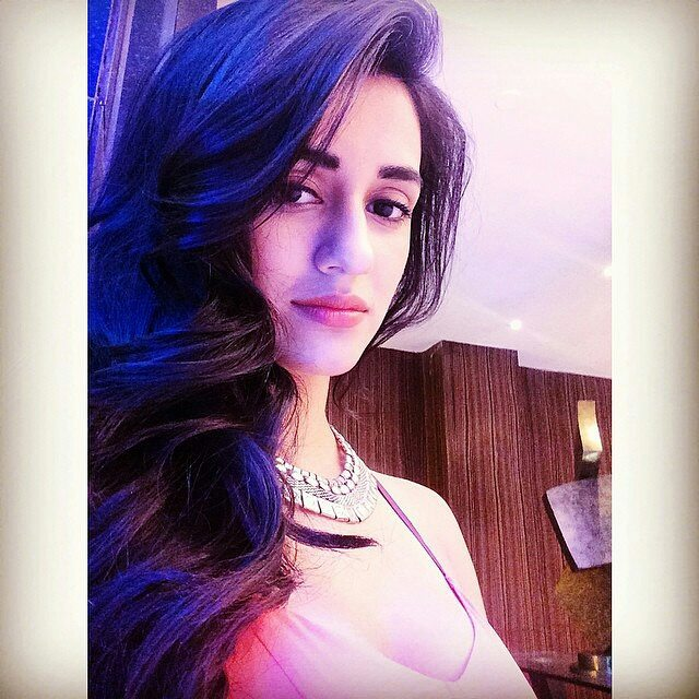 India Tv - Disha Patani likes to keep a pink or nude lip gloss in her beauty bag