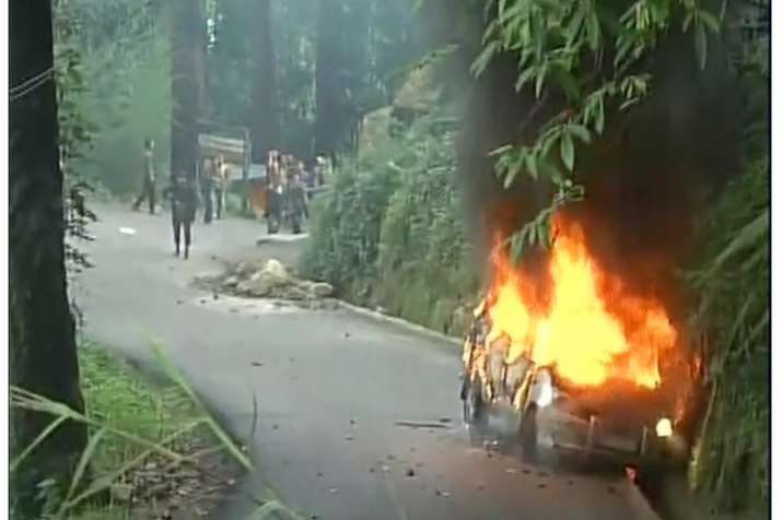 India Tv - Activists turn violent after raid on GJM chief, vandalise cars