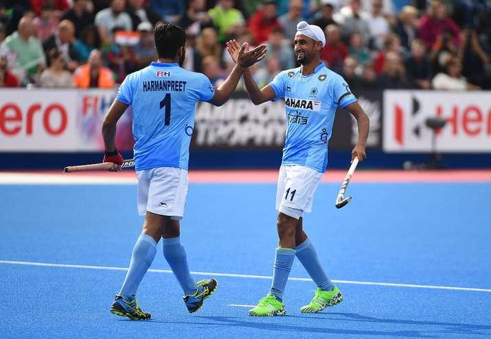 Harmanpreet Singh of India celebrates his goal with Mandeep