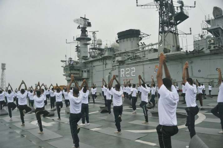 India Tv - Indian Navy Officers celebrating Yoga Day on INS Viraat
