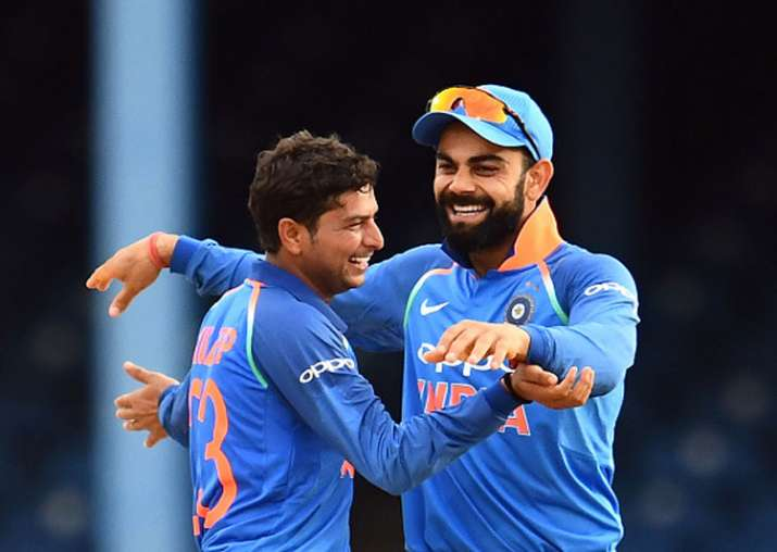 Virat Kohli and Kuldeep Yadav celebrate a dismissal against
