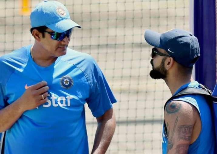 Anil Kumble and Virat Kohli interact during India's