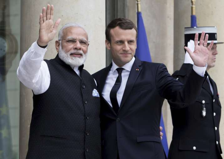 Macron welcomes PM Modi at Elysee Palace in Paris