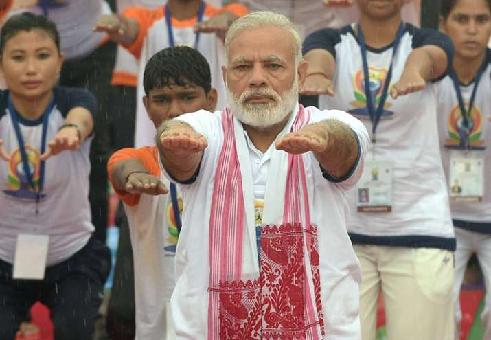 Modi performs yoga along with thousands of others in Lucknow