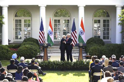 India Tv - President Trump and PM Modi hug at White House