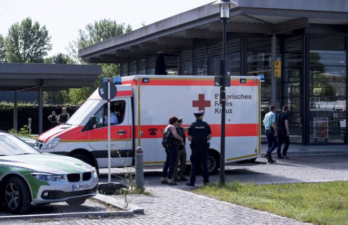 An ambulance stands near a subway station in Munich after
