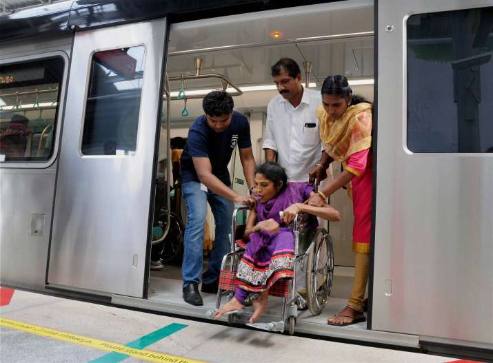 Differently abled passenger being helped during 'sneha