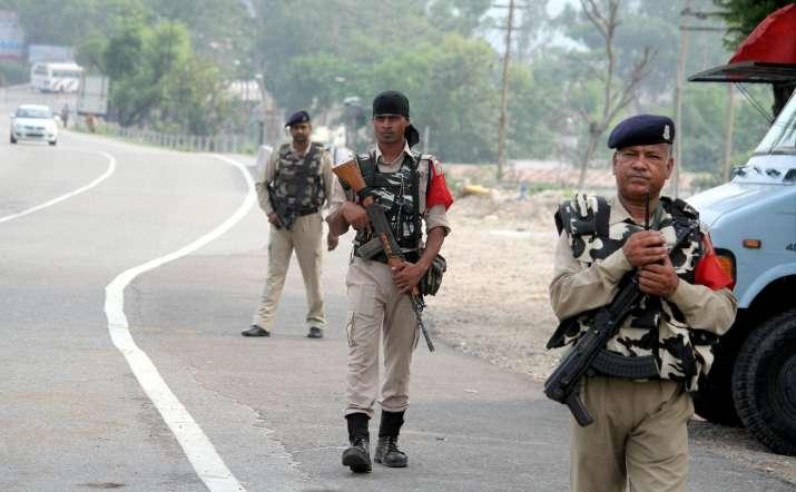 CRPF personnel patrol on Jammu-Srinagar highway on the eve