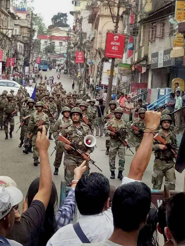 India Tv - CRPF troops patrol the streets in Darjeeling