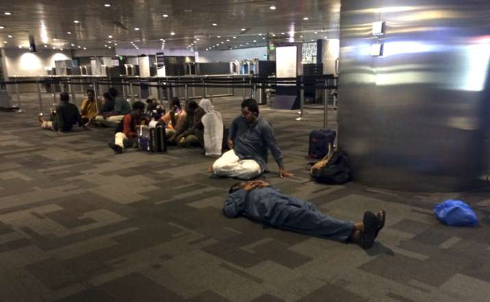 Passengers of cancelled flights wait at Doha Airport