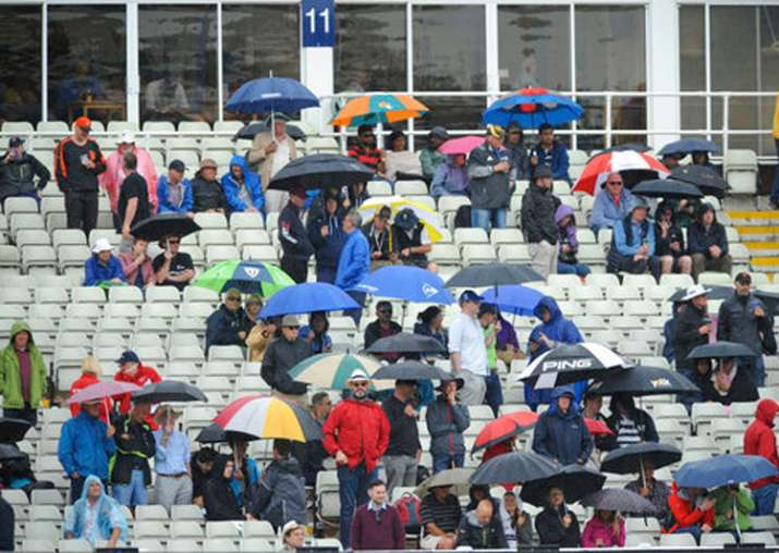 Spectators waiting for the rain to end in Birmingham during
