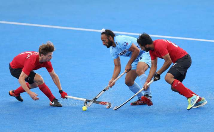 Sardar Singh of India battles for possession with Foris Van