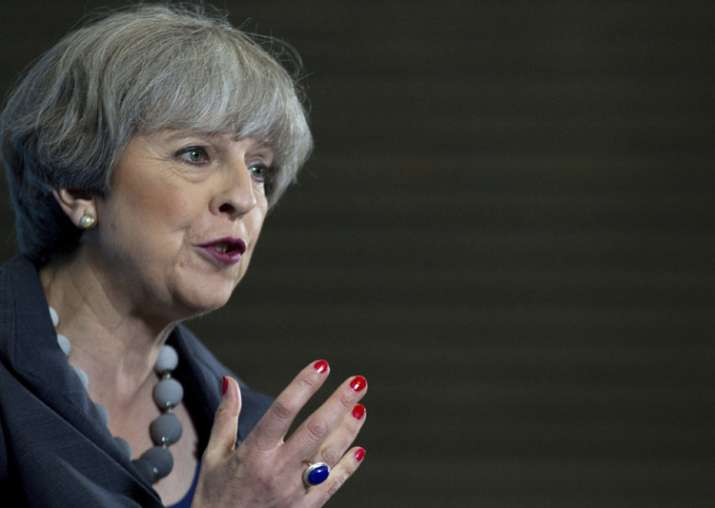 Britain's PM and Conservative party leader Theresa May